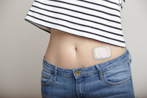 Disposable pod of cartridge-based wearable device
